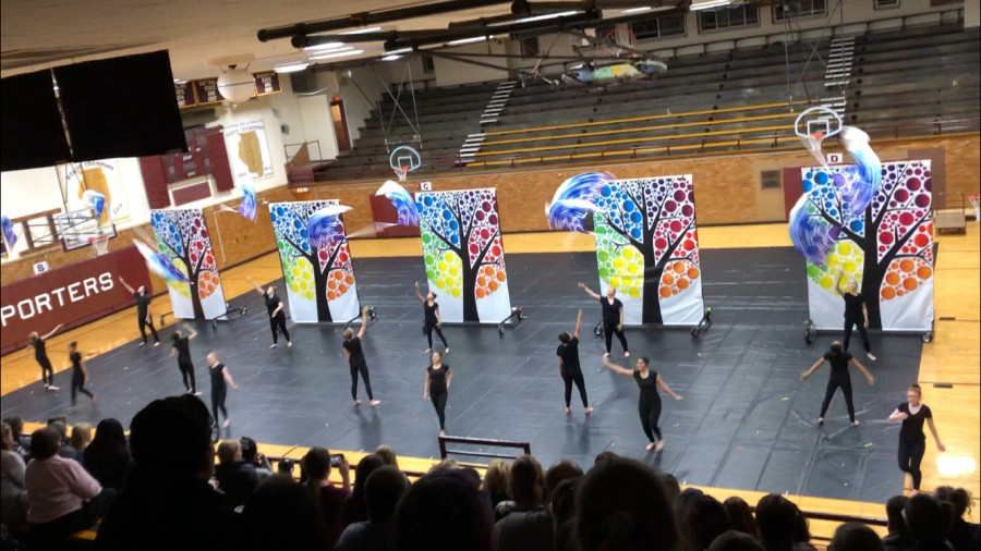 The JV Winter Guard does a beautiful double during their show.