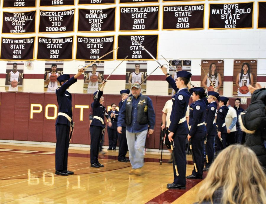 ROTC cadets respectfully welcoming the Veterans