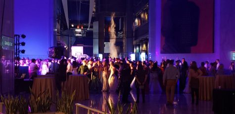 Guests and attendees dancing in the main hall of the Museum of Science and Industry, where prom took place.