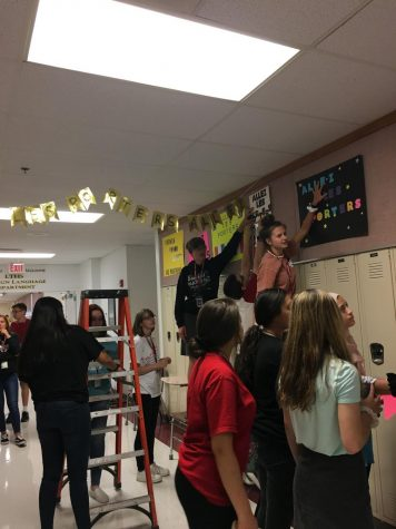 The French National Honor Society (FNHS) decorates the east halls for homecoming week.